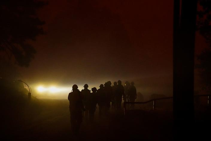 "The Laguna Hotshots Crew out of the Cleveland National Forest walk down Huntington Lake Road to battle the Creek Fire in Big Creek. <span class=""copyright"">(Kent Nishimura/Los Angeles Times)</span>"
