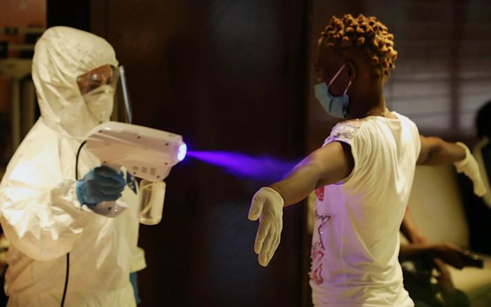 A health worker sprays sanitizer on a migrant domestic worker from Africa before she gets tested for the coronavirus in a hotel, ahead of her travel to her country. Lebanon - Reuters