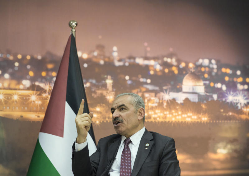 """Palestinian Prime Minister Mohammad Shtayyeh italks during an interview with The Associated Press, at his office in the West Bank city of Ramallah, Tuesday, April 16, 2019. Stayyeh accused the United States of declaring """"financial war"""" on his people and said an American peace plan purported to be in the works will be """"born dead."""" (AP Photo/Nasser Nasser)"""