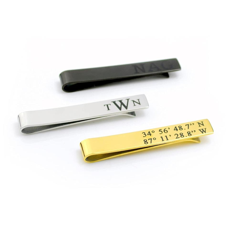 <p>Give them something meaningful like this <span>Hidden Message Tie Bar</span> ($30). You can customize it with their initials, a hidden message, or something sentimental. You can choose from a variety of fonts and styles as well. </p>