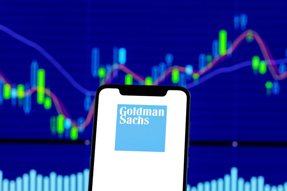HONG KONG, CHINA - 2018/12/28:  In this photo illustration, the Goldman Sachs logo is seen displayed on an Android smartphone over stock chart. (Photo Illustration by Daniel Fung/SOPA Images/LightRocket via Getty Images)