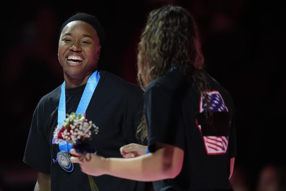 Simone Manuel and Abbey Weitzeil ccelebrate at the medal ceremony after the women's 50 freestyle during wave 2 of the U.S. Olympic Swim Trials on Sunday, June 20, 2021, in Omaha, Neb. (AP Photo/Jeff Roberson)