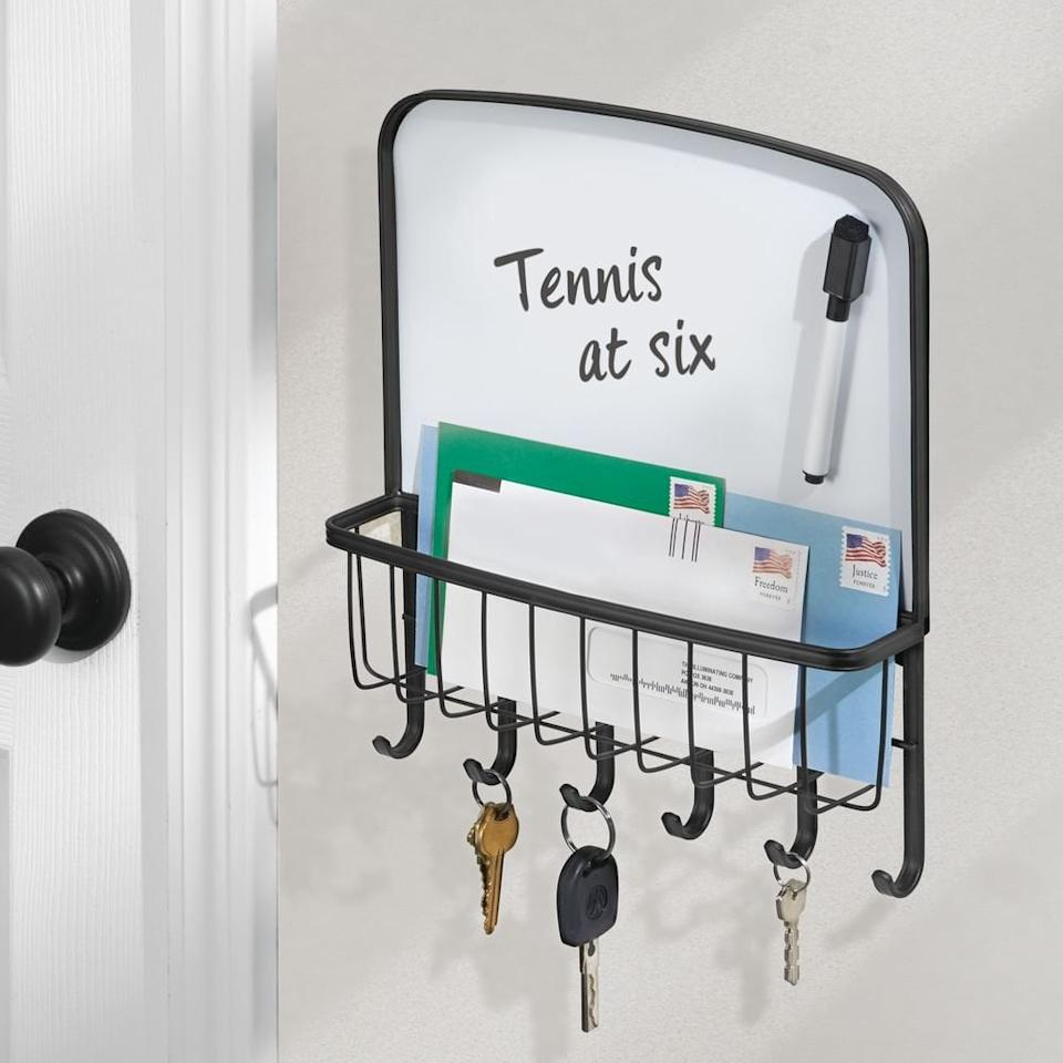 "<p>You'll never lose your keys again with this handy <a href=""https://www.popsugar.com/buy/mDesign-Metal-Wall-Mount-Entryway-Storage-Organizer-488307?p_name=mDesign%20Metal%20Wall%20Mount%20Entryway%20Storage%20Organizer&retailer=amazon.com&pid=488307&price=18&evar1=casa%3Aus&evar9=46583359&evar98=https%3A%2F%2Fwww.popsugar.com%2Fphoto-gallery%2F46583359%2Fimage%2F46585399%2FmDesign-Metal-Wall-Mount-Entryway-Storage-Organizer&list1=shopping%2Corganization%2Chome%20organization%2Chome%20shopping&prop13=api&pdata=1"" rel=""nofollow"" data-shoppable-link=""1"" target=""_blank"" class=""ga-track"" data-ga-category=""Related"" data-ga-label=""https://www.amazon.com/mDesign-Organizer-Dry-Erase-Entryway-Kitchen/dp/B0733BYRFB?ref_=ast_sto_dp"" data-ga-action=""In-Line Links"">mDesign Metal Wall Mount Entryway Storage Organizer</a> ($18).</p>"