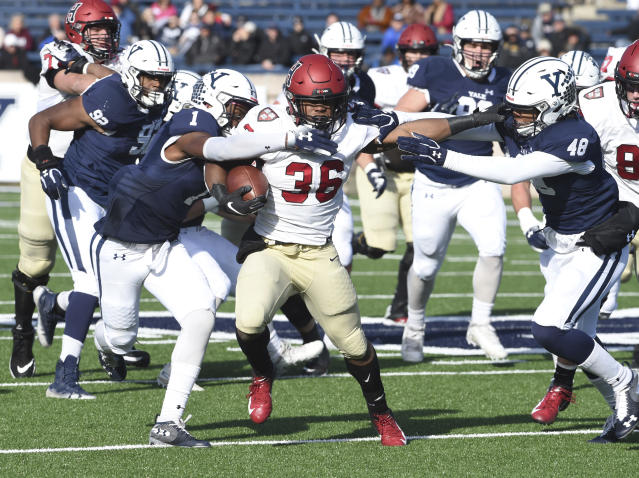 Harvard's Devin Darrington runs against Yale during the first half during an NCAA college football game, Saturday, Nov. 23, 2019, in New Haven, Conn. (Arnold Gold/New Haven Register via AP)