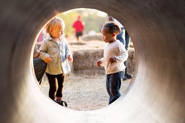 A Trip To The Park Reminded Me That My Black Children Aren't Safe: Kids playing in a tunnel