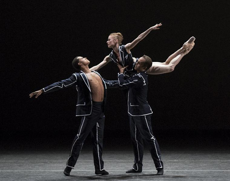 In this Sept. 20, 2016 photo released by the New York City Ballet, Preston Chamblee, from left, Lauren King, and Jared Angle perform in costumes designed by Rosie Assoulin at the New York City Ballet fall gala. (Paul Kolnik/New York City Ballet via AP)