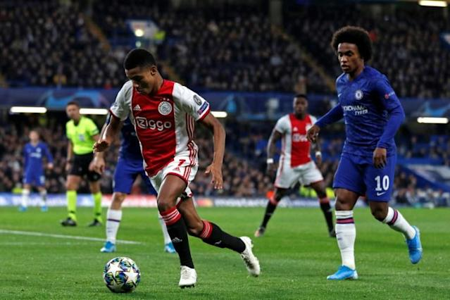 Neres (L) played against Chelsea on Tuesday (AFP Photo/Adrian DENNIS)