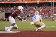 UCLA wide receiver Kyle Philips (2) catches a pass for a touchdown in front of Stanford safety Kendall Williamson (21) during the second half of an NCAA college football game Saturday, Sept. 25, 2021, in Stanford, Calif. UCLA won 35-24. (AP Photo/Tony Avelar)