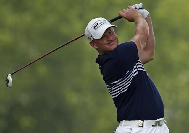 Jamie Donaldson, of Wales, watches his tee shot on the 12th hole during the first round of the PGA Championship golf tournament at Valhalla Golf Club on Thursday, Aug. 7, 2014, in Louisville, Ky. (AP Photo/Mike Groll)