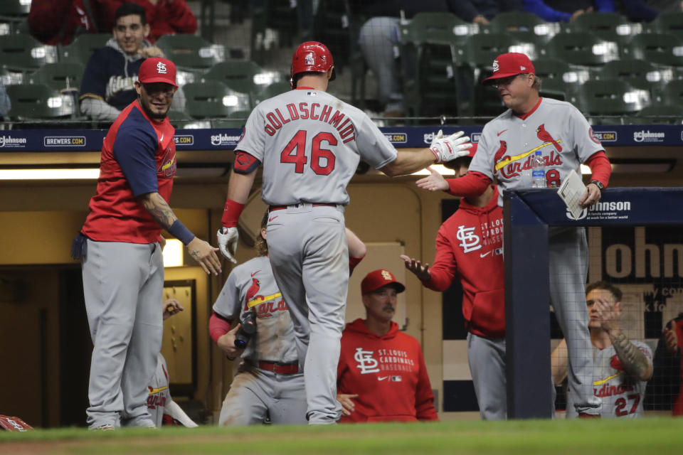 St. Louis Cardinals' Paul Goldschmidt (46) is congratulated at the dugout after hitting a two-run home run during the 11th inning of the team's baseball game against the Milwaukee Brewers on Tuesday, May 11, 2021, in Milwaukee. (AP Photo/Aaron Gash)