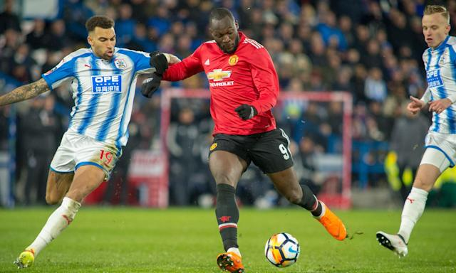 Romelu Lukaku lines up his shot before scoring his second goal in Manchester United's 2-0 victory over Huddersfield Town in the fifth round of the FA Cup.