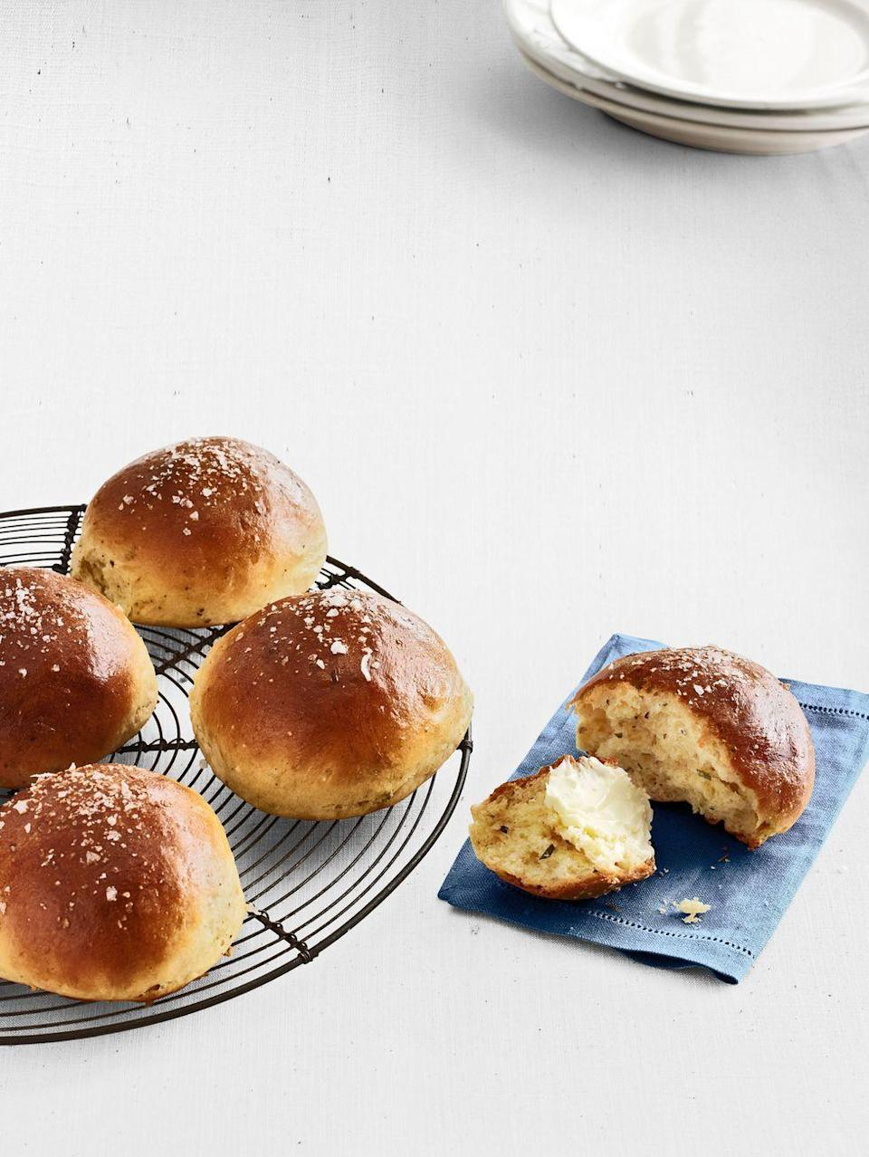 "<p>The addition of fresh herbs makes these rich, buttery brioche rolls special. Studded with rosemary and black pepper, and topped with coarse salt, these rolls are fragrant and flavorful.</p><p><strong><a href=""https://www.countryliving.com/food-drinks/recipes/a4961/rosemary-brioche-rolls-recipe-clx0414/"" rel=""nofollow noopener"" target=""_blank"" data-ylk=""slk:Get the recipe"" class=""link rapid-noclick-resp"">Get the recipe</a>.</strong></p>"