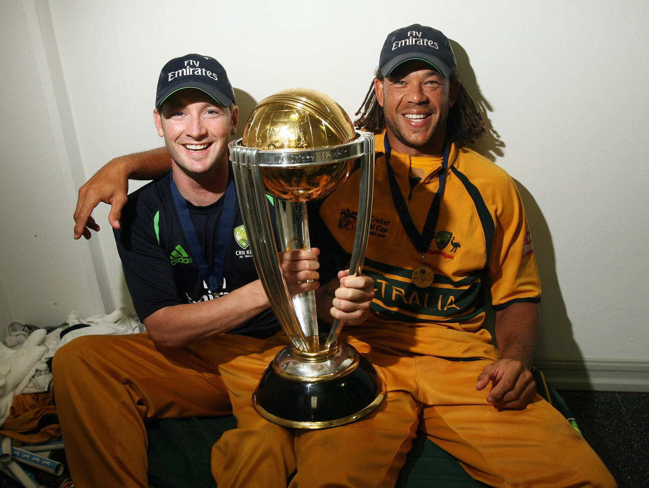 BRIDGETOWN, BARBADOS - APRIL 28:  Michael Clarke and Andrew Symonds of Australia pose with the ICC World Cup trophy in the changing rooms after the ICC Cricket World Cup Final between Australia and Sri Lanka at the Kensington Oval on April 28, 2007 in Bridgetown, Barbados.  (Photo by Hamish Blair/Getty Images)