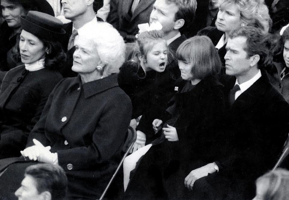 Barbara Bush (second from left) sits in front of her son George W. Bush (far right) and granddaughters Jenna (third from right) and Barbara at the presidential inauguration of George H.W. Bush in January 1989.