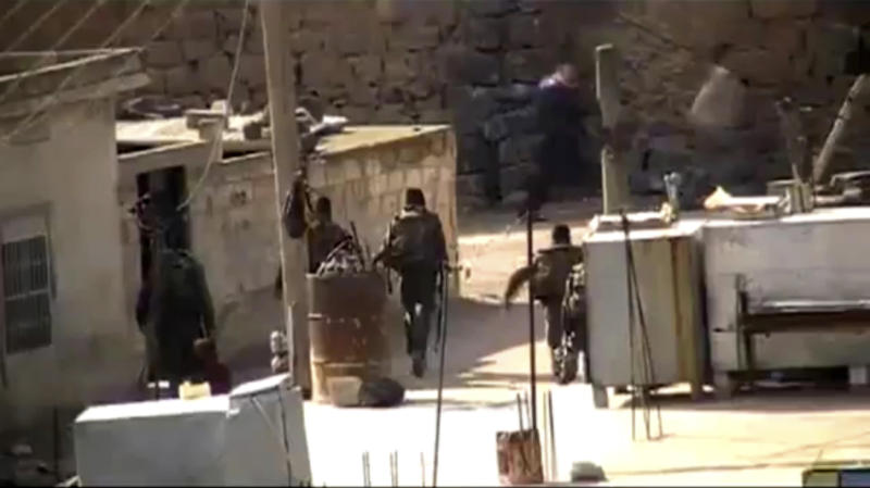 This image from amateur video made available by Shaam News Network on Tuesday, Jan. 17, 2012, purports to show gangs of Bashar Assad loyalists in the village of Inkhil, Daraa, Syria. (AP Photo/Shaam News Network via APTN) THE ASSOCIATED PRESS CANNOT INDEPENDENTLY VERIFY THE CONTENT, DATE, LOCATION OR AUTHENTICITY OF THIS MATERIAL.  TV OUT