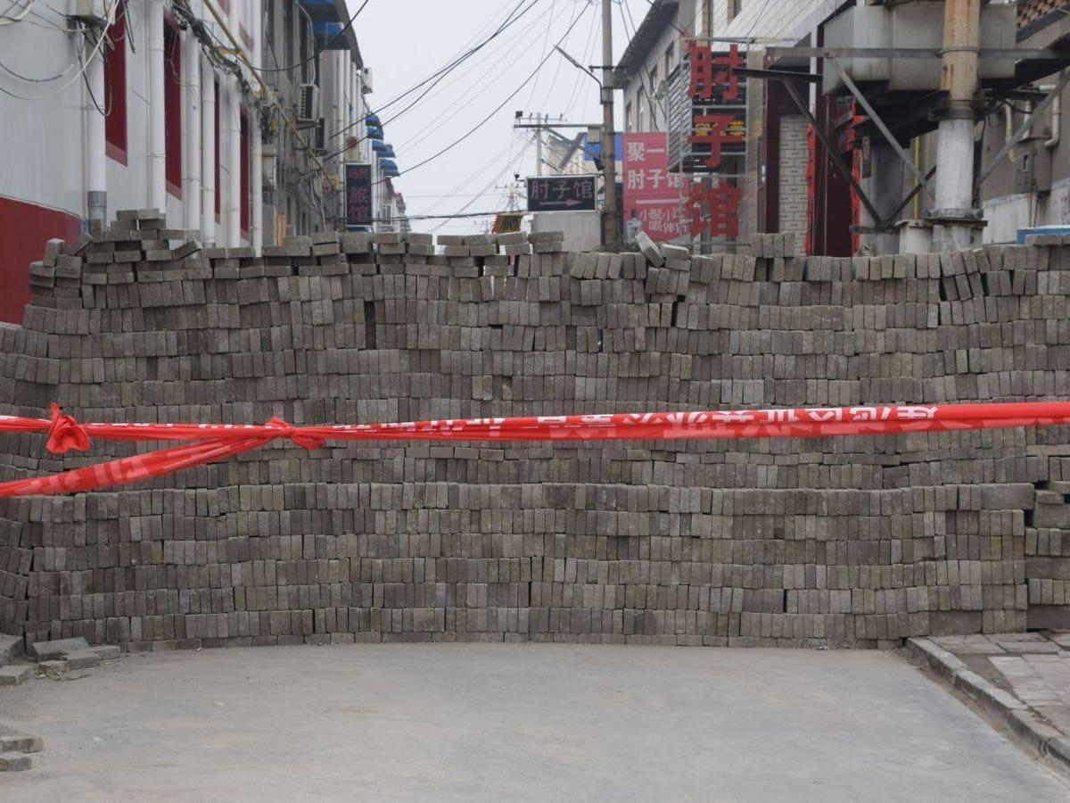 Chinese villages are cutting themselves off from the world with makeshift brick walls to try to stop outsiders from giving them the Wuhan virus