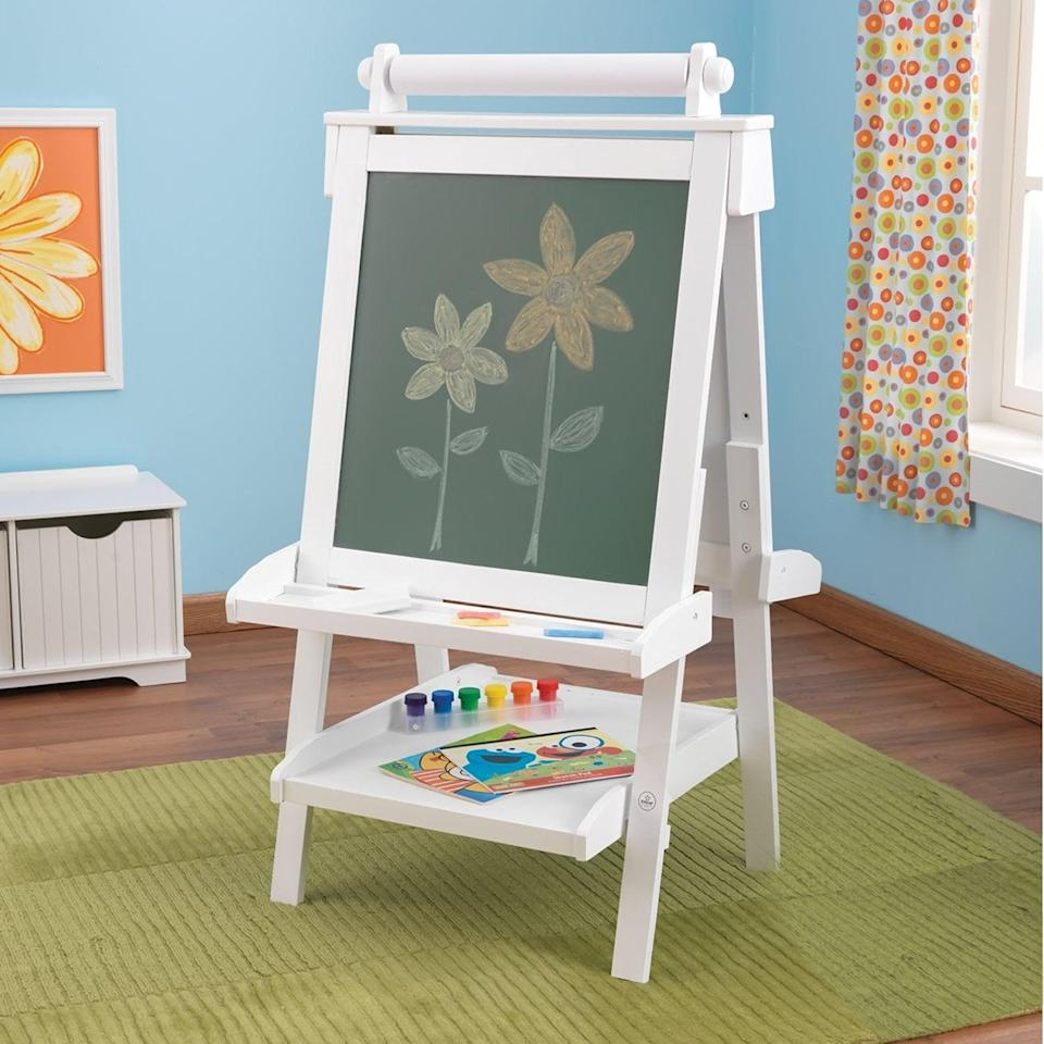 "<p>Give children a chance to express themselves with the <a href=""https://www.popsugar.com/buy/KidKraft-Deluxe-Wood-Easel-490903?p_name=KidKraft%20Deluxe%20Wood%20Easel&retailer=amazon.com&pid=490903&price=95&evar1=moms%3Aus&evar9=25800161&evar98=https%3A%2F%2Fwww.popsugar.com%2Fphoto-gallery%2F25800161%2Fimage%2F44870150%2FKidKraft-Deluxe-Wood-Easel&list1=gifts%2Choliday%2Cgift%20guide%2Cparenting%2Cautism%2Clittle%20kids%2Ckid%20shopping%2Choliday%20for%20kids%2Cgifts%20for%20toddlers%2Cbest%20of%202019&prop13=api&pdata=1"" class=""link rapid-noclick-resp"" rel=""nofollow noopener"" target=""_blank"" data-ylk=""slk:KidKraft Deluxe Wood Easel"">KidKraft Deluxe Wood Easel</a> ($95).</p>"