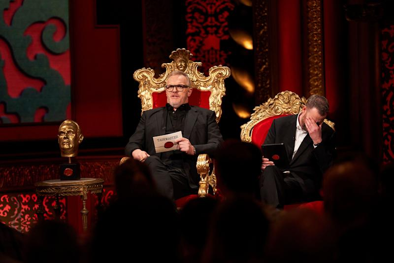 On CW's 'Taskmaster,' Taskmaster Greg Davies, left, makes a pronouncement that doesn't appear to go over well with his sidekick, Alex Horne.