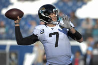 FILE - In this Nov. 24, 2019, file photo, Jacksonville Jaguars quarterback Nick Foles warms up before an NFL football game against the Tennessee Titans in Nashville, Tenn. A person familiar with the trade says the Jacksonville Jaguars have agreed to send quarterback Nick Foles to the Chicago Bears for a compensatory fourth-round draft pick. The person spoke to The Associated Press on condition of anonymity because trades don't become official until the league year begins later Wednesday, March 18, 2020. (AP Photo/Mark Zaleski, File)