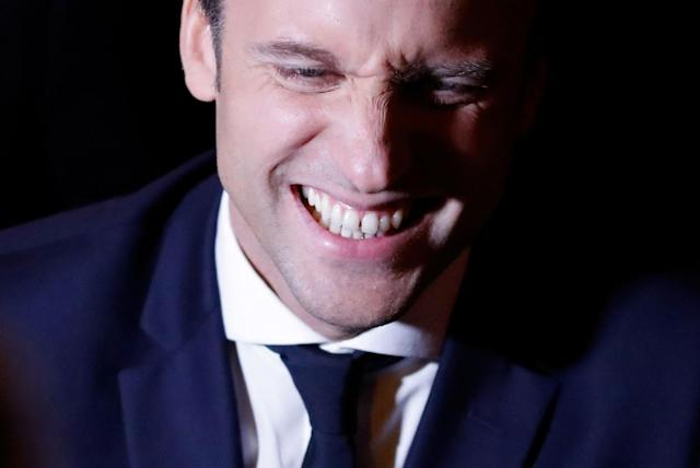 <p>Emmanuel Macron, head of the political movement En Marche !, or Onwards !, and candidate for the 2017 French presidential election, leaves his campaign headquarters in Paris after early results in the first round of 2017 French presidential election, France, April 23, 2017. (Christian Hartmann/Reuters) </p>