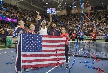 Feb 11, 2018; Asheville, NC, USA;Coco Vandeweghe (USA), Team Captain, Kathy Rinaldi, Venus Williams (USA), Serena Williams (USA) and Lauren Davis (USA) celebrate the USA the Fed Cup tie against the Netherlands at U.S. Cellular Center. Mandatory Credit: Susan Mullane-USA TODAY Sports
