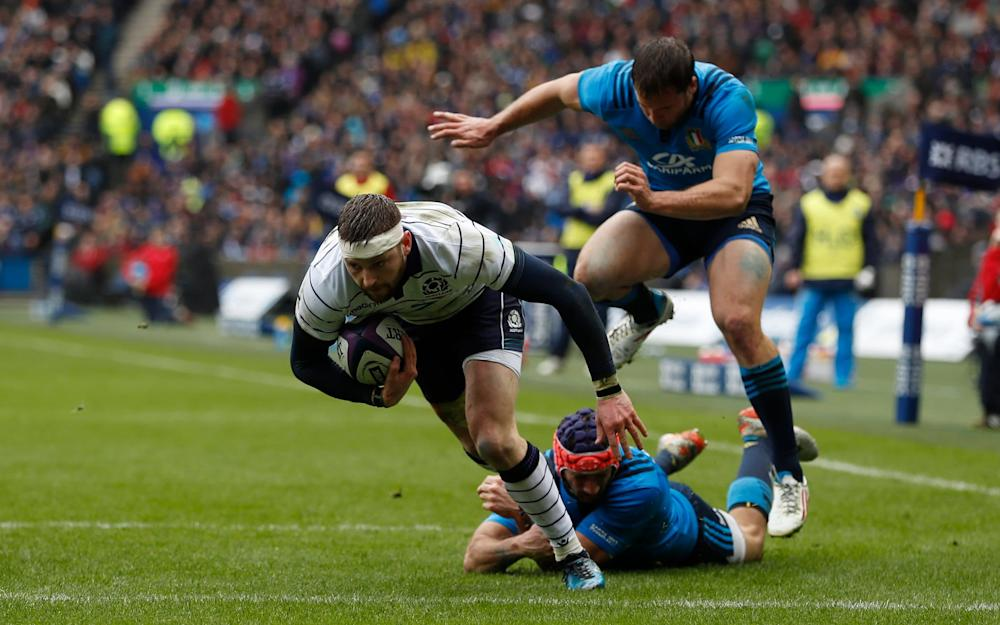 Finn Russell scores Scotland's first try - Credit: Reuters