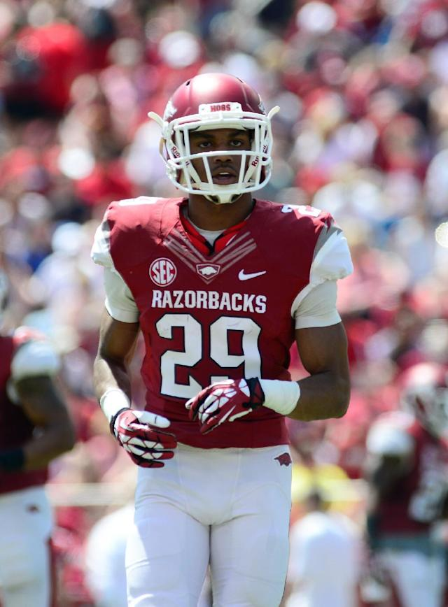 Arkansas' Jared Collins (29) takes the field before a play during their spring NCAA college football game, Saturday, April 26, 2014, in Fayetteville, Ark. (AP Photo/Sarah Bentham)