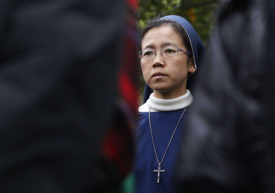 A nun looks on during a re-enactment of the stations of the cross in Taipei March 31, 2012. Hundreds of Taiwan's Christians marked the start of Easter on Saturday with a detailed re-enactment of the Christ's death on the cross.