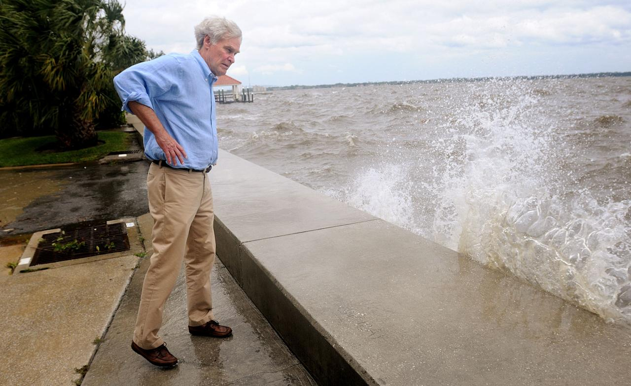 Rep. Ander Crenshaw, Fla., comes down to the riverfront and gets surprised by high waves crashing into the sea wall just prior to a news conference about the effects of Tropical Storm beryl on the Northeast Florida area Monday afternoon, May 28, 2012. Crenshaw who lives on the 8th floor of the Villa Riva building on Riverside Avenue got to see the effects of the storm first hand. (AP Photo/The Florida Times-Union, Kelly Jordan)