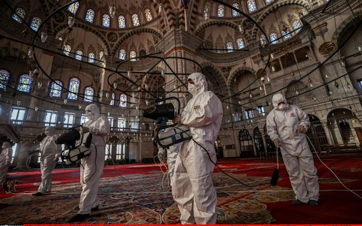 Officials carry out disinfection works at Fatih Mosque in Istanbul - disinfection is regularly carried out in in 346 mosques as part of the coronaviruscontrol measures. - mrah Yorulmaz/Anadolu Agency via Getty Images