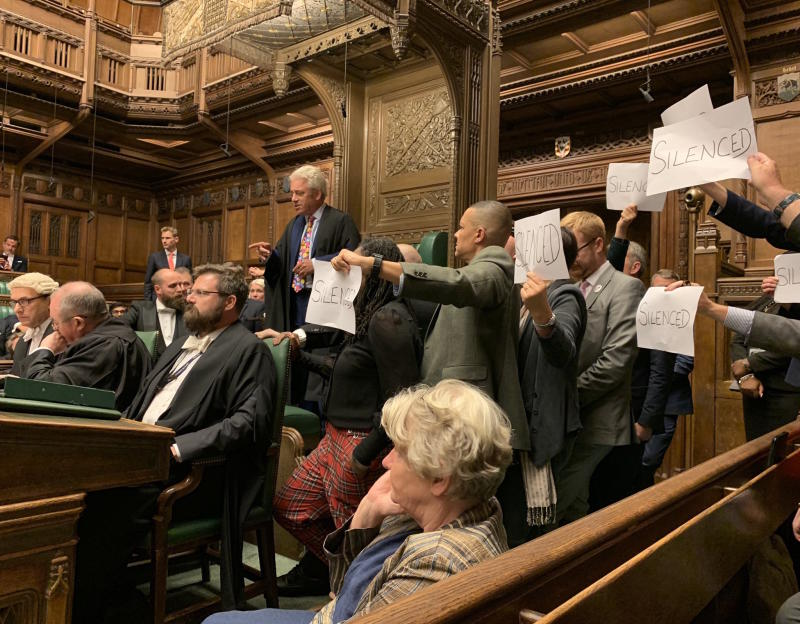 "Speaker John Bercow is surrounded by Labour MPs holding paper with ""silenced"" written on them"