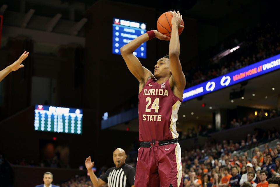 Devin Vassell #24 of the the Florida State Seminoles shoots in the first half during a game against the Virginia Cavaliers at John Paul Jones Arena.