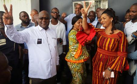 FILE PHOTO: Felix Tshisekedi, leader of the Congolese main opposition party, the Union for Democracy and Social Progress (UDPS), and a presidential candidate, shows a victory sign after casting his ballot at a polling station in Kinshasa, Democratic Republic of Congo, December 30, 2018. REUTERS/Kenny Katombe/File Photo