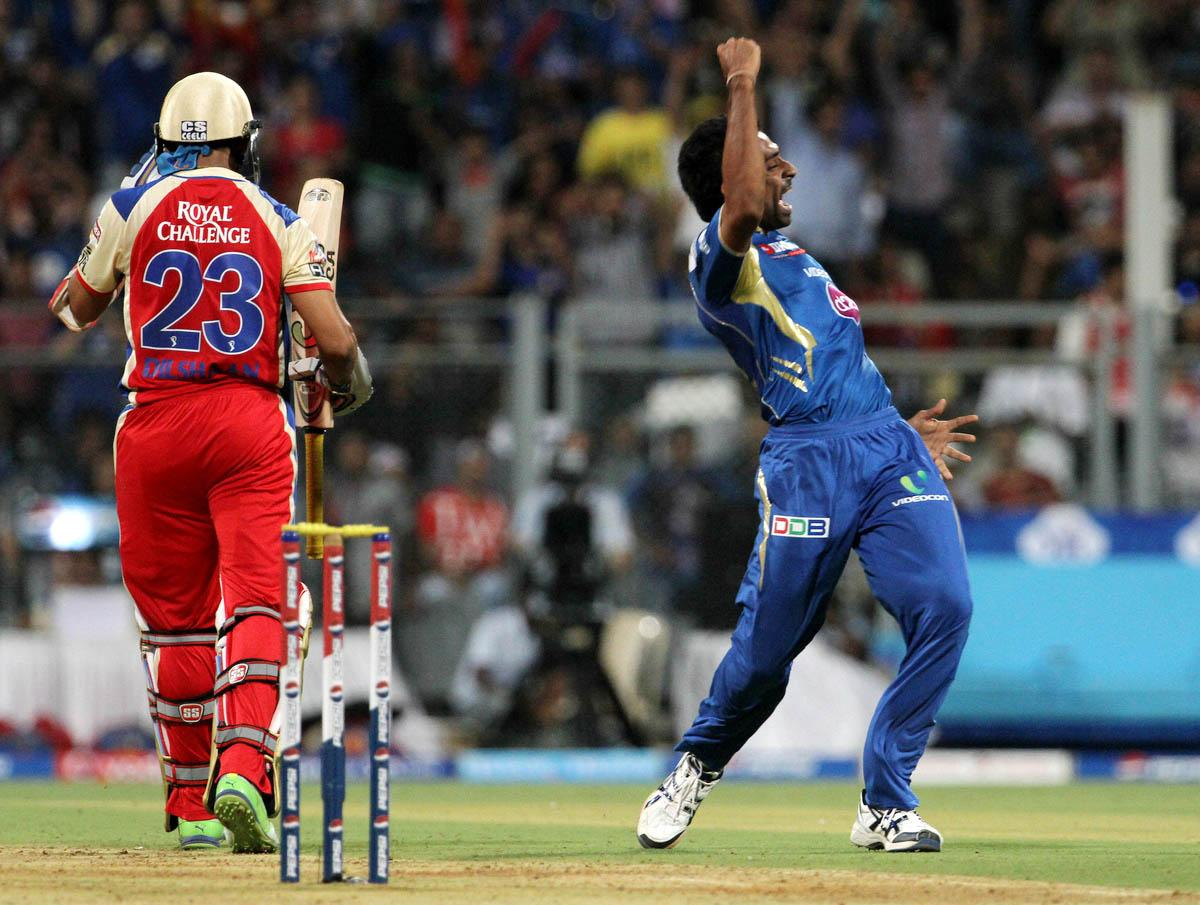 Mumbai Indian player Dhawal Kulkarni celebrates after he takes a the wicket of Royal Challengers Bangalore player Tillakaratne Dilshan during match 37 of the Pepsi Indian Premier League ( IPL) 2013  between The Mumbai Indians and the Royal Challengers Bangalore held at the Wankhede Stadium in Mumbai on the 27th April 2013. (BCCI)