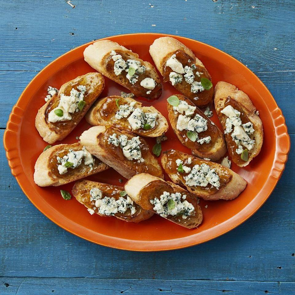 """<p>The combination of sweet fig jam and tangy blue cheese is perfect for Thanksgiving. Serve it on slices of toasted baguette for a quick pre-dinner snack. </p><p><a href=""""https://www.thepioneerwoman.com/food-cooking/recipes/a34425195/fig-blue-cheese-bruschetta/"""" rel=""""nofollow noopener"""" target=""""_blank"""" data-ylk=""""slk:Get Ree's recipe."""" class=""""link rapid-noclick-resp""""><strong>Get Ree's recipe.</strong></a></p>"""