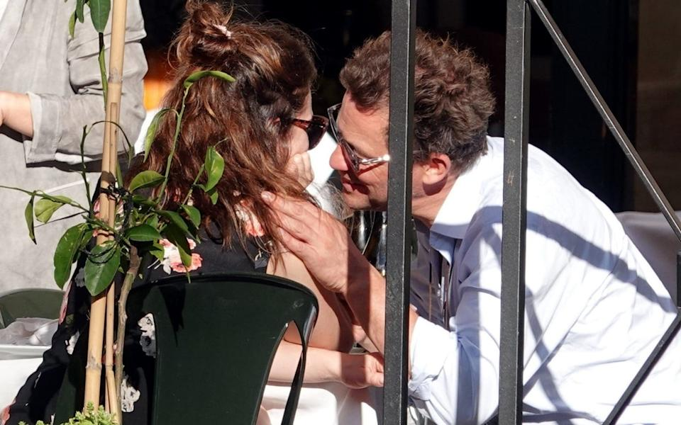 Dominic West and Lily James appeared to be a bit close for comfort - Backgrid