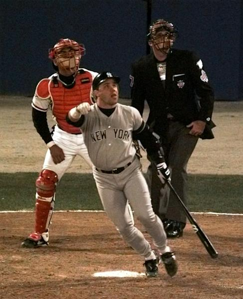 FILE - In this Oct. 23, 1996 file photo, New York Yankees' Jim Leyritz watches his eighth inning three-run home run with Atlanta Braves catcher Eddie Perez and plate umpire Steve Rippley during Game 4 of the World Series in Atlanta. The Yankees began their run of four titles in five years with a victory over Atlanta in the 1996 World Series. (AP Photo/Ron Frehm, File)
