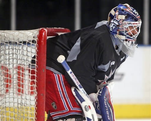 New York Rangers' Henrik Lundqvist, of Sweden, stands in the net during NHL hockey practice at Madison Square Garden in New York, Tuesday, May 22, 2012. For the third straight series, Rangers return home from a Game 4 loss and try to regain control. The Rangers have one day to regroup before they welcome the New Jersey Devils back to Madison Square Garden for Game 5 of the Eastern Conference finals Wednesday night. (AP Photo/Seth Wenig)