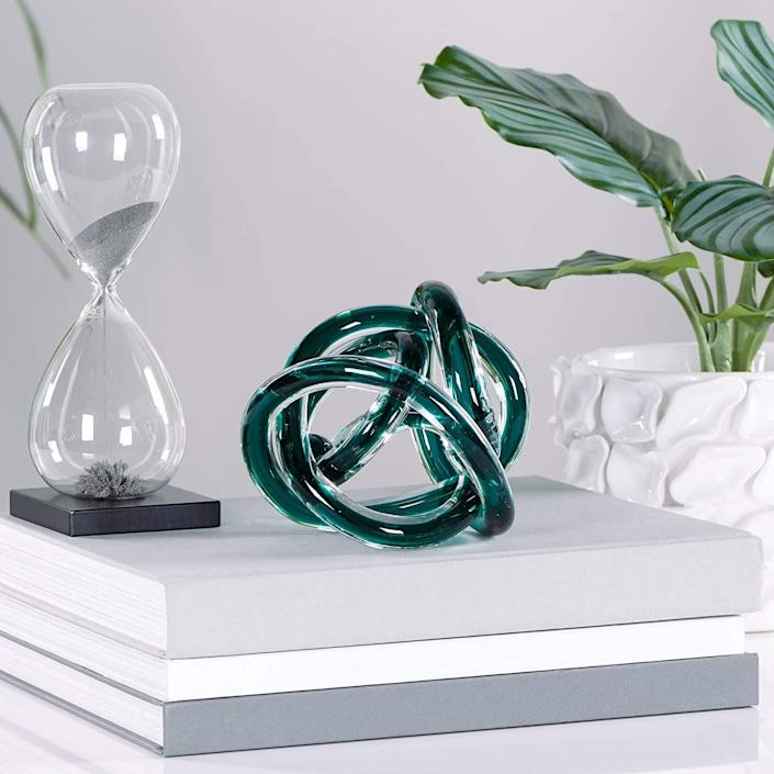 <p>This compliment-worthy <span>Torre &amp; Tagus Orbit Glass Décor Ball</span> ($28) will command attention whenever you have guests over. Its mere presence will add style and texture to any surface.</p>