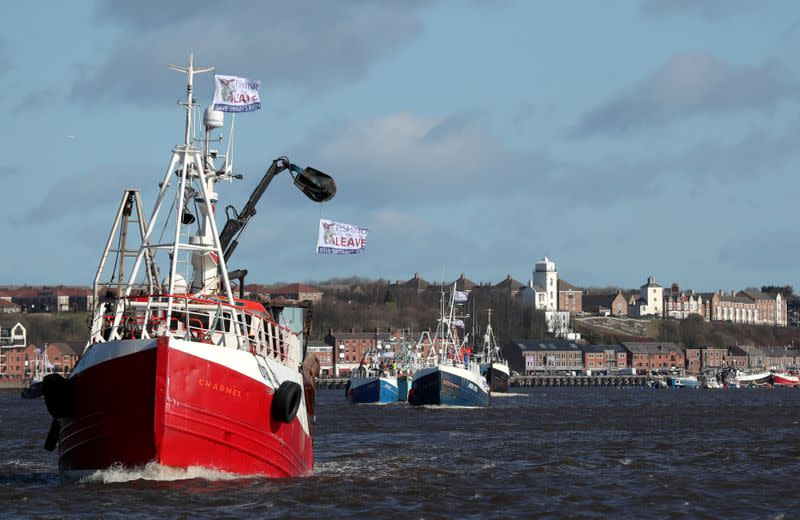 FILE PHOTO: Fishing boats take part in a Brexit flotilla, organised by Fishing For Leave, in Newcastle upon Tyne