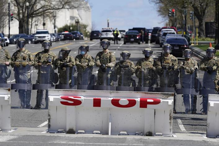 Troops stand guard near the scene.
