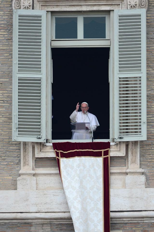 VATICAN CITY, VATICAN - MARCH 17: Pope Francis delivers his Angelus prayer and blessing to the pilgrims gathered in St Peter's Square on March 17, 2013 in Vatican City, Vatican.The Vatican is preparing for the inauguration of Pope Francis on March 19, 2013 in St Peter's Square. (Photo by Jeff J Mitchell/Getty Images)