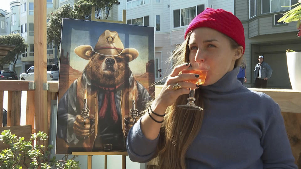 In this Feb. 12, 2021 photo, a customer drinks an alcohol-free cocktail at San Francisco's zero-proof bar Ocean Beach Cafe. According to IWSR Drinks Market Analysis, global consumption of zero-proof beer, wine and spirits is growing two to three times faster than overall alcohol consumption. (AP Photo/Haven Daley)