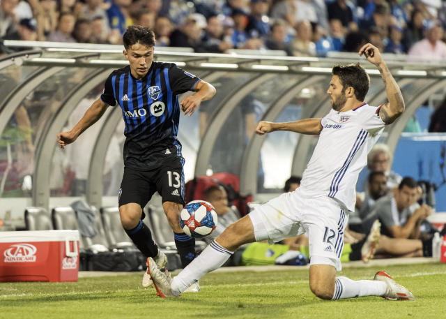 Montreal Impact's Ken Krolicki, left, challenges FC Dallas' Ryan Hollingshead during second-half MLS soccer match action in Montreal, Saturday, Aug. 17, 2019. (Graham Hughes/The Canadian Press via AP)