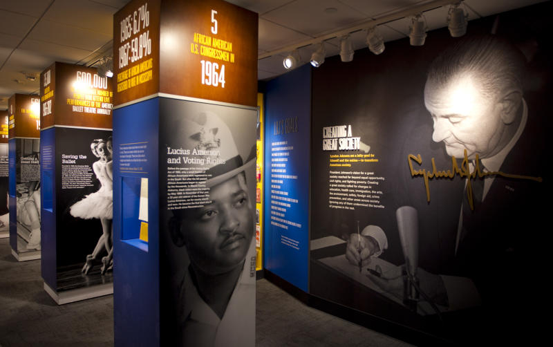 In this Dec. 11, 2012 photo, new exhibits about Lyndon Baines Johnson's presidency are displayed at the LBJ Presidential Library in Austin. An insider's look at how Johnson delt with challenges is on display at the newly remodeled LBJ Presidential Library in Austin, where the old 1970s-style exhibits now use 21st century technology to put visitors in Johnson's shoes. Mark Updegrove, the library's director, said the reopening comes as historians take a fresh look at Johnson's efforts to fight poverty and improve the health of the nation by creating a Great Society. (AP Photo/Statesman.com, Jay Janner) MAGS OUT; NO SALES; INTERNET AND TV MUST CREDIT PHOTOGRAPHER AND STATESMAN.COM