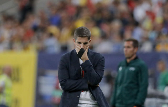 Spain's coach Robert Moreno grimaces during the Euro 2020 group F qualifying soccer match between Romania and Spain, at the National Arena stadium in Bucharest, Romania, Thursday, Sept. 5, 2019. (AP Photo/Vadim Ghirda)