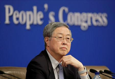 FILE PHOTO: Zhou Xiaochuan, Governor of the People's Bank of China, attends a news conference in Beijing