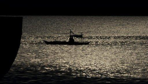 A plane buzzed Philippine fishermen between the western Philippine island of Palawan and the disputed Spratly islands