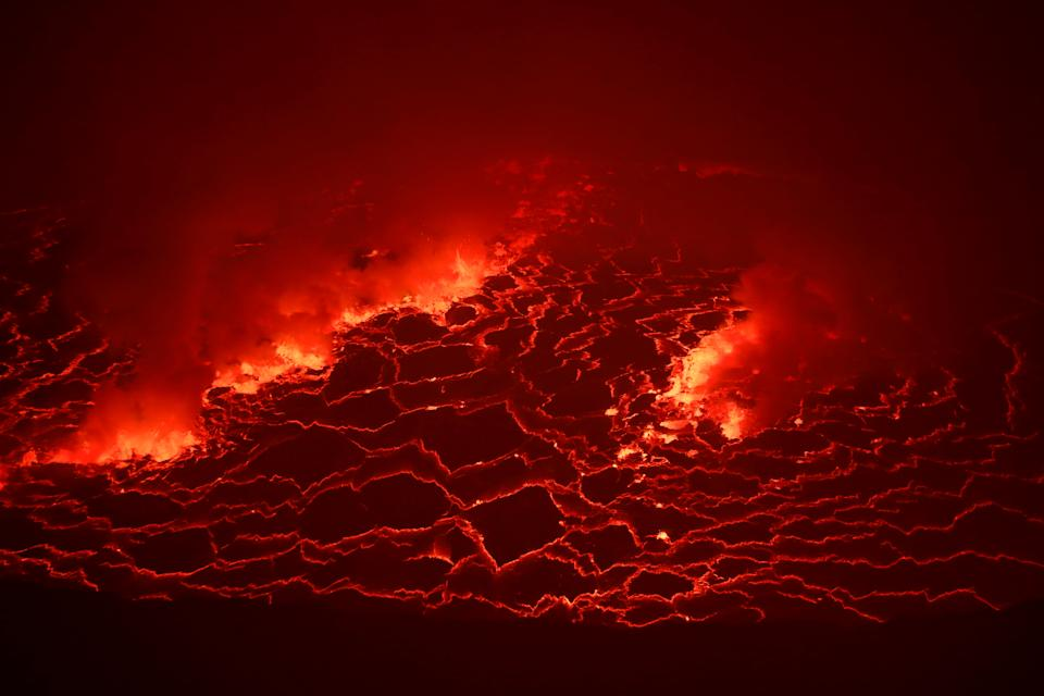 Lava is seen glowing inside the crater of the Nyiragongo volcano inside the Virunga National Park near the eastern Congolese city of Goma. Source: Reuters/Baz Ratner