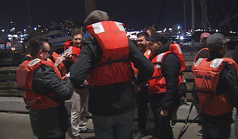"This image provided by KTVU-TV shows some of the 22 rescued passengers on the pier Friday Oct.12, 2012 in San Francisco. A U.S. Coast Guard spokesman said the wine-tasting boat, Neptune hit a shoal near Alcatraz Island and began sinking.  Nearly two dozen people who were enjoying a boat ride on what's billed as San Francisco Bay's only ""floating wine tasting room"" are OK after their vessel hit a shoal near Alcatraz Island and started sinking Friday night. U.S. Coast Guard spokesman Lt. j.g. Josh Dykman says the 45-foot Neptune hit the shoal around 8:42 p.m. and started taking on water after the impact left a 1-foot gash in the side of the boat. The boat's captain tried to get it back to Pier 39, where the boat is docked, but the captain had difficulty navigating the vessel and it started sinking. Dykman says three Coast Guard boats took all 22 passengers and crewmembers off the vessel and brought them back to the pier. There were no injuries.(AP Photo/KTVU-TV)"